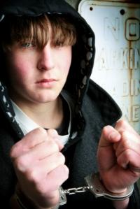 teen prisoner in handcuffs